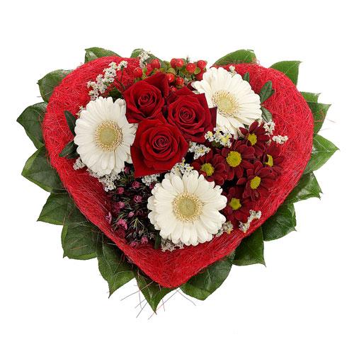 Blumenstrauss mit herzförmiger Sisal-Manschette von Dominik GmbH & Co. Pflanzenvertriebs-KG
